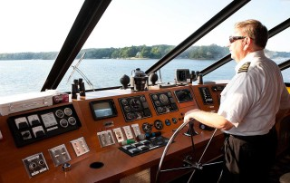 Captain Ron at the Wheel of the Lady of the Lake