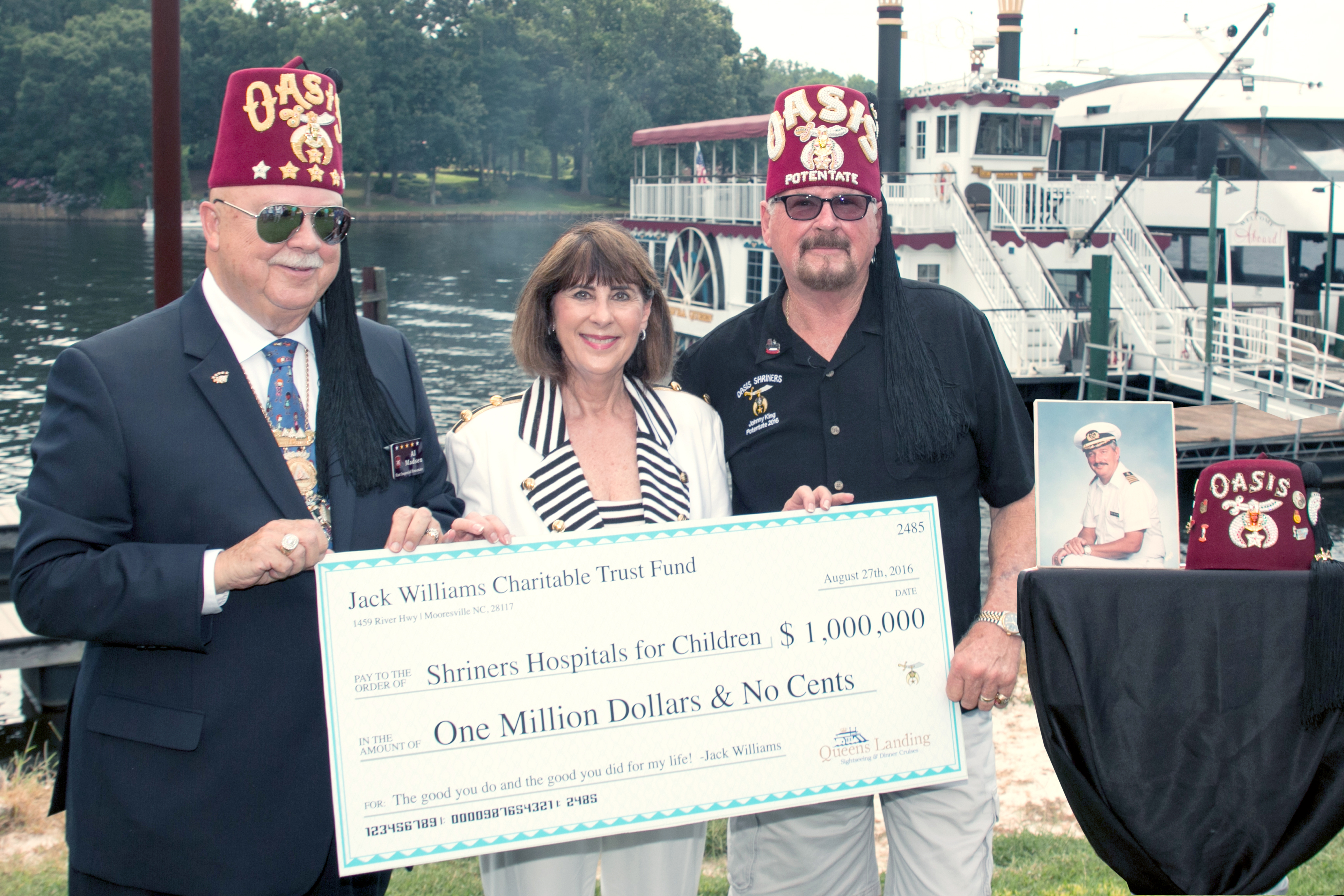 Past Imperial Potentate Al Madsen (left) and current Potentate of the Oasis Temple Johnny King (right), received a $1 million donation on Saturday for the Shriners Hospitals for Children from the Trust Fund of the late Jack R. Williams. Williams was the owner of Queens Landing in Mooresville, NC. Presenting the check on his behalf was Vice-President of the company Deborah Harwell (center).